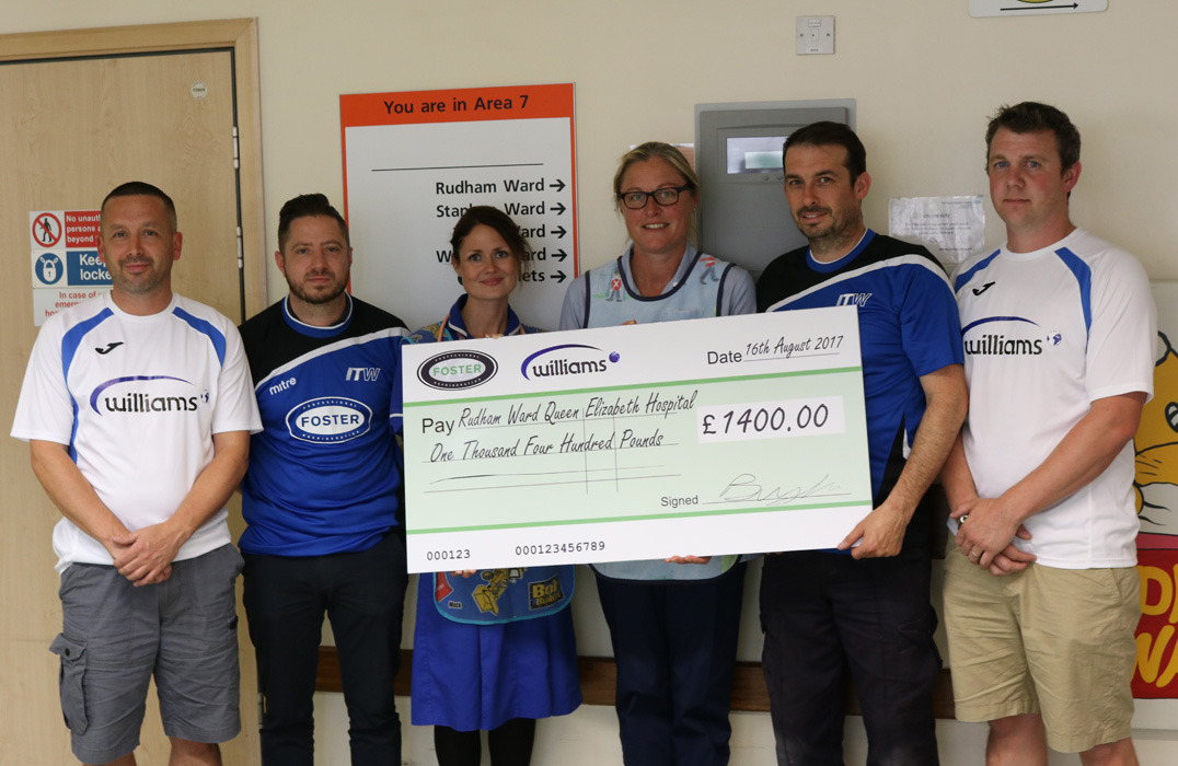 Williams and Fosters Players present check to Rudham Ward.